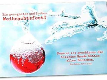 Christliche Weihnachtskarte: Verschneiter Tannenzweig