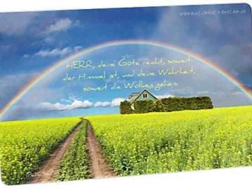 Christliche Postkarte: Regenbogen über Rapsfeld - Psalmwort: Psalm 36,5