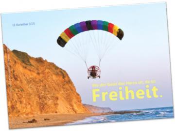 Christliches Poster A2: Motorgleitschirm vor Steilküste